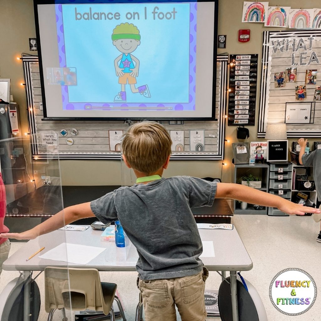 student balancing on one foot during a fluency and fitness activity